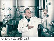 Купить «Wine maker controls quality of wine», фото № 27245723, снято 12 октября 2016 г. (c) Яков Филимонов / Фотобанк Лори