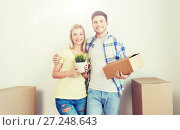 Купить «smiling couple with big boxes moving to new home», фото № 27248643, снято 25 февраля 2016 г. (c) Syda Productions / Фотобанк Лори