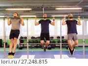 Купить «group of young men doing pull-ups in gym», фото № 27248815, снято 19 февраля 2017 г. (c) Syda Productions / Фотобанк Лори