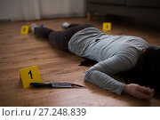 Купить «dead woman body lying on floor at crime scene», фото № 27248839, снято 5 мая 2017 г. (c) Syda Productions / Фотобанк Лори