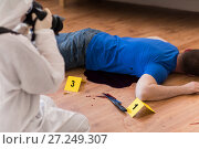 Купить «criminalist photographing dead body at crime scene», фото № 27249307, снято 5 мая 2017 г. (c) Syda Productions / Фотобанк Лори