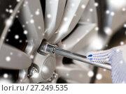 Купить «auto mechanic with screwdriver changing car tire», фото № 27249535, снято 1 июля 2016 г. (c) Syda Productions / Фотобанк Лори