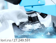 Купить «close up of hand with microscope and powder sample», фото № 27249591, снято 4 декабря 2014 г. (c) Syda Productions / Фотобанк Лори
