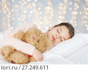 Купить «girl sleeping with teddy bear toy in bed», фото № 27249611, снято 6 декабря 2015 г. (c) Syda Productions / Фотобанк Лори
