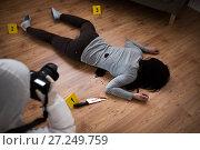 Купить «criminalist photographing dead body at crime scene», фото № 27249759, снято 5 мая 2017 г. (c) Syda Productions / Фотобанк Лори