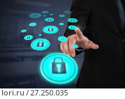 Купить «Businessperson touching security lock icons», фото № 27250035, снято 26 апреля 2019 г. (c) Wavebreak Media / Фотобанк Лори