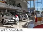 Купить «Selling cars Toyota in the showroom. New products automaker Toyota», фото № 27251083, снято 25 мая 2017 г. (c) Евгений Ткачёв / Фотобанк Лори