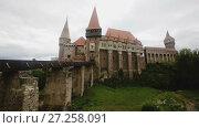 Купить «View of Corvin Castle, Gothic-Renaissance castle in Hunedoara, Romania», видеоролик № 27258091, снято 19 октября 2017 г. (c) Яков Филимонов / Фотобанк Лори