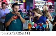 Купить «Group of smiling people clubbing in the night club with drinks», видеоролик № 27258111, снято 11 августа 2017 г. (c) Яков Филимонов / Фотобанк Лори