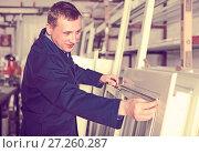 Купить «Production worker with PVC windows», фото № 27260287, снято 30 марта 2017 г. (c) Яков Филимонов / Фотобанк Лори
