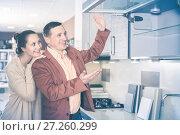 Купить «Couple looking at modern kitchen», фото № 27260299, снято 4 апреля 2017 г. (c) Яков Филимонов / Фотобанк Лори