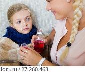 Купить «Stressed woman giving liquid medicine to little girl with grippe», фото № 27260463, снято 21 апреля 2019 г. (c) Яков Филимонов / Фотобанк Лори