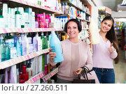 Купить «Two women choosing shampoo», фото № 27260511, снято 11 декабря 2017 г. (c) Яков Филимонов / Фотобанк Лори