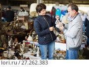 Купить «positive mature spouses buying retro handicrafts on flea market», фото № 27262383, снято 23 октября 2017 г. (c) Яков Филимонов / Фотобанк Лори