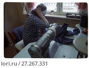 Купить «Женщина шьет одежду на швейной машине. Женская тюрьма», фото № 27267331, снято 16 июня 2019 г. (c) Борис Кавашкин / Фотобанк Лори