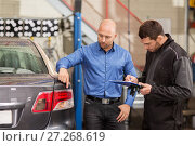 Купить «mechanic and customer looking at car taillight», фото № 27268619, снято 21 сентября 2017 г. (c) Syda Productions / Фотобанк Лори