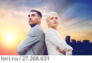 Купить «businessman and businesswoman outdoors», фото № 27268631, снято 19 августа 2014 г. (c) Syda Productions / Фотобанк Лори