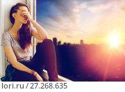 Купить «unhappy teenage girl sitting on windowsill», фото № 27268635, снято 19 декабря 2015 г. (c) Syda Productions / Фотобанк Лори