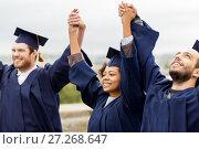 Купить «happy students celebrating graduation», фото № 27268647, снято 24 сентября 2016 г. (c) Syda Productions / Фотобанк Лори