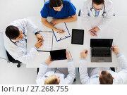 Купить «doctors with cardiogram and computers at hospital», фото № 27268755, снято 4 апреля 2017 г. (c) Syda Productions / Фотобанк Лори
