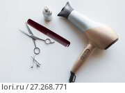 Купить «hairdryer, scissors, comb and styling hair spray», фото № 27268771, снято 12 апреля 2017 г. (c) Syda Productions / Фотобанк Лори