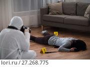 Купить «criminalist photographing dead body at crime scene», фото № 27268775, снято 5 мая 2017 г. (c) Syda Productions / Фотобанк Лори