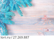 Купить «New Year and Christmas background. Blue fir tree branches on the wooden background. New Year and Christmas festive still life, free space for text», фото № 27269887, снято 8 мая 2017 г. (c) Зезелина Марина / Фотобанк Лори