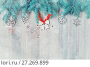 Купить «Christmas background. Christmas toys, blue fir tree on the wooden background. Christmas still life with free space for text», фото № 27269899, снято 8 мая 2017 г. (c) Зезелина Марина / Фотобанк Лори