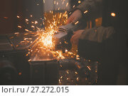 Купить «Bright sparks - metal workshop - worker grinding metal construction with a circular saw, close up», фото № 27272015, снято 7 декабря 2017 г. (c) Константин Шишкин / Фотобанк Лори