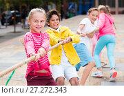 Купить «Cheerful children are competing and tug of war», фото № 27272343, снято 7 сентября 2017 г. (c) Яков Филимонов / Фотобанк Лори