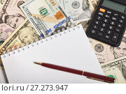 Купить «Notepad with blank sheet, pen and calculator on a background of different dollar bills. The concept of planning», фото № 27273947, снято 7 декабря 2017 г. (c) Юлия Бабкина / Фотобанк Лори