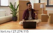 Купить «man with laptop shopping online at new home», видеоролик № 27274115, снято 30 ноября 2017 г. (c) Syda Productions / Фотобанк Лори