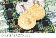 Купить «Digital cryptocurrency bitcoin lying over electronic computer component. Business concept of new virtual money», фото № 27275335, снято 30 ноября 2017 г. (c) FotograFF / Фотобанк Лори