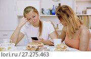 Купить «Young girl is comforting her sad girlfriend at her home.», видеоролик № 27275463, снято 17 октября 2017 г. (c) Яков Филимонов / Фотобанк Лори