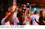 Купить «Group of smiling people clubbing in the night club with drinks», видеоролик № 27275483, снято 11 сентября 2017 г. (c) Яков Филимонов / Фотобанк Лори