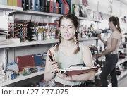 Купить «teenager buying different products in stationery shop», фото № 27277075, снято 9 мая 2017 г. (c) Яков Филимонов / Фотобанк Лори