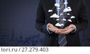 Купить «cloud app icons connected and Businessman with hands palm open and dark background», фото № 27279403, снято 21 марта 2019 г. (c) Wavebreak Media / Фотобанк Лори