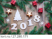 Купить «Happy New Year 2018 background with 2018 figures, Christmas toys, blue fir tree branches. New Year 2018 card», фото № 27280171, снято 29 ноября 2016 г. (c) Зезелина Марина / Фотобанк Лори