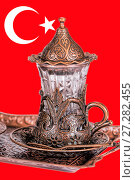 Купить «Turkish tea set. Ottoman teacup with traditional arabic ornaments on white background», фото № 27282455, снято 27 декабря 2015 г. (c) Евгений Ткачёв / Фотобанк Лори