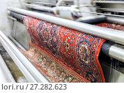 Купить «Automatic washing and cleaning of carpets. Industrial line for washing carpets», фото № 27282623, снято 19 июня 2017 г. (c) Евгений Ткачёв / Фотобанк Лори
