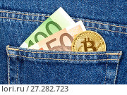 Купить «Euro banknotes and golden Bitcoin sticking out of the blue jeans pocket. Business concept of digital cryptocurrency», фото № 27282723, снято 11 декабря 2017 г. (c) FotograFF / Фотобанк Лори