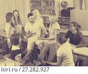 Купить «Happy students during break in classroom», фото № 27282927, снято 17 декабря 2018 г. (c) Яков Филимонов / Фотобанк Лори
