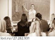 Купить «Student girl standing at blackboard», фото № 27282931, снято 21 января 2020 г. (c) Яков Филимонов / Фотобанк Лори