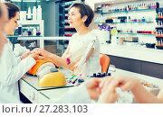 Купить «attentive female manicurist filing and shaping nails in beauty salon», фото № 27283103, снято 28 апреля 2017 г. (c) Яков Филимонов / Фотобанк Лори