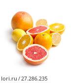 Купить «Mix of citrus fruits on a white background.», фото № 27286235, снято 14 ноября 2017 г. (c) Olesya Tseytlin / Фотобанк Лори
