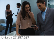 Купить «Businessman discussing with his coworker over mobile phone», фото № 27287527, снято 3 сентября 2017 г. (c) Wavebreak Media / Фотобанк Лори