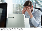 Купить «Frustrated executive sitting near the window with hand on head», фото № 27287655, снято 3 сентября 2017 г. (c) Wavebreak Media / Фотобанк Лори