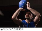 Купить «Player playing basketball», фото № 27288043, снято 21 октября 2017 г. (c) Wavebreak Media / Фотобанк Лори