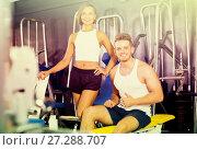 Купить «man and woman fitness coaches in gym», фото № 27288707, снято 4 октября 2016 г. (c) Яков Филимонов / Фотобанк Лори