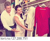 Купить «Family choosing dress and blouse at clothing shop», фото № 27288751, снято 24 октября 2016 г. (c) Яков Филимонов / Фотобанк Лори